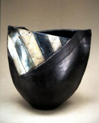 Raku bowl with silver nitrate stripes