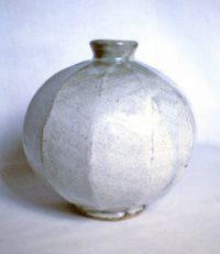 Cut sided stoneware vase with ash glaze
