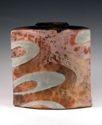 John bedding flattened vase fumed with metallic salts