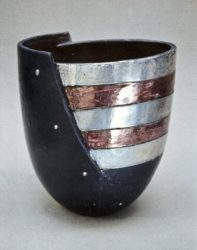 John bedding cut and shaped bowl with silver nitrate and copper glazed stripes