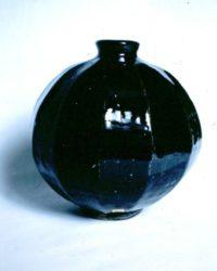 John bedding cut sided stoneware vase in Tenmoku glaze